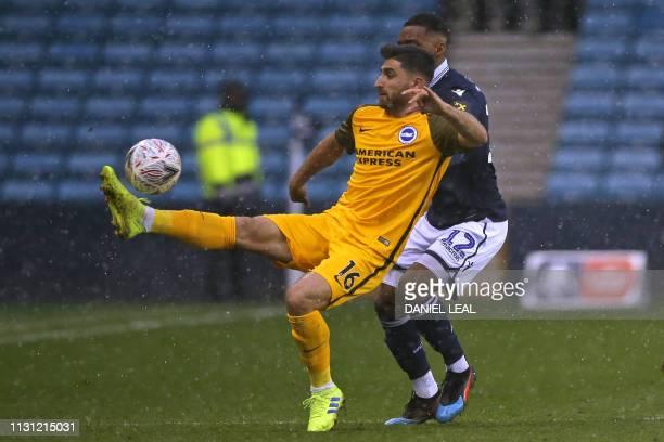 Brighton's Iranian midfielder Alireza Jahanbakhsh vies with Millwall's Englishborn Antiguan defender Mahlon Romeo during the English FA Cup...