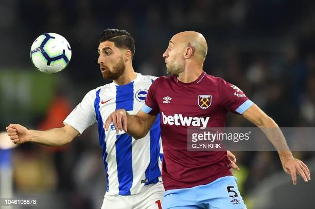 Brighton's Iranian midfielder Alireza Jahanbakhsh vies with West Ham United's Argentinian defender Pablo Zabaleta during the English Premier League...