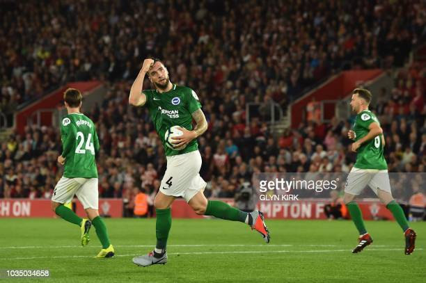 Brighton's Irish defender Shane Duffy celebrates after scoring the team's first goal during the English Premier League football match between...