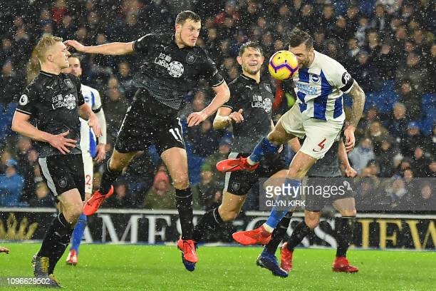 Brighton's Irish defender Shane Duffy jumps to head home their first goal during the English Premier League football match between Brighton and Hove...