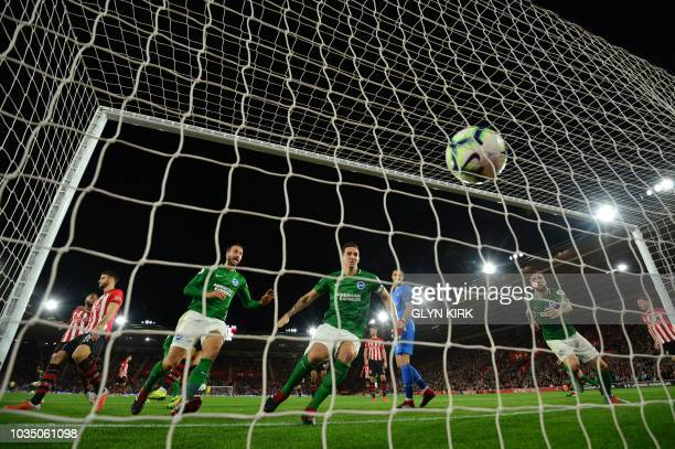 Brighton's Irish defender Shane Duffy scores the team's first goal during the English Premier League football match between Southampton and Brighton...