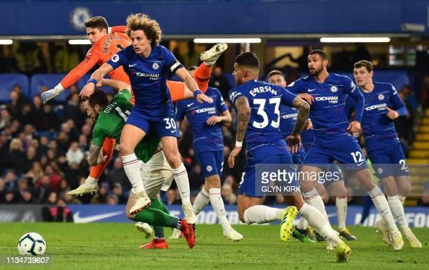 Brighton's Irish defender Shane Duffy vies with Chelsea's Spanish goalkeeper Kepa Arrizabalaga and Chelsea's Brazilian defender David Luiz during the...