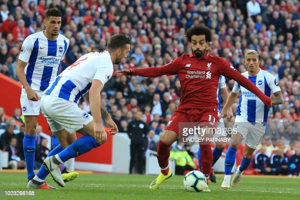 Brighton's Irish defender Shane Duffy vies with Liverpool's Egyptian midfielder Mohamed Salah during the English Premier League football match...