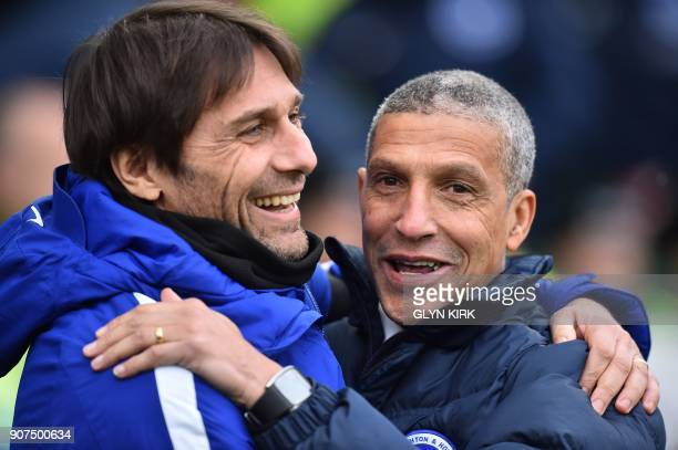 Brighton's Irish manager Chris Hughton greets Chelsea's Italian head coach Antonio Conte ahead of the English Premier League football match between...