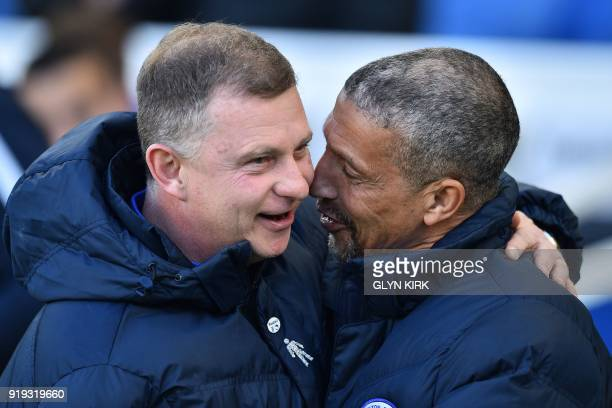 Brighton's Irish manager Chris Hughton greets Coventry City's English manager Mark Robins ahead of the English FA Cup fifth round football match...