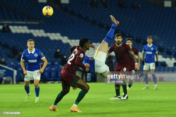 Brighton's Irish striker Aaron Connolly tires on overhead kick that is saved during the English Premier League football match between Brighton and...