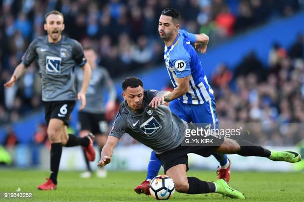 Brighton's Israeli midfielder Beram Kayal vies with Coventry City's English striker Jonson ClarkeHarris during the English FA Cup fifth round...