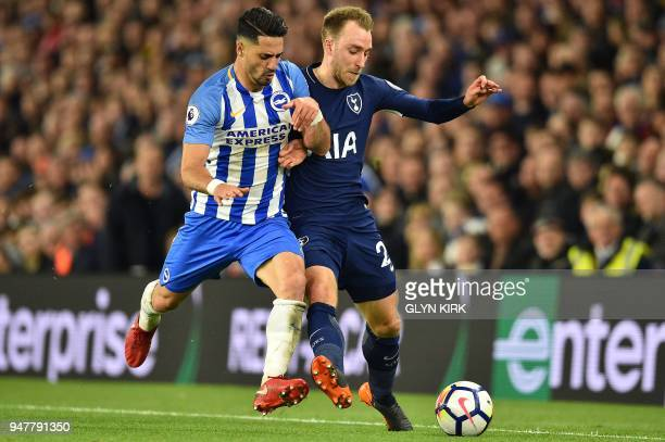 Brighton's Israeli midfielder Beram Kayal vies with Tottenham Hotspur's Danish midfielder Christian Eriksen during the English Premier League...