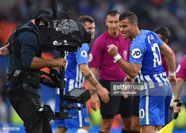 Brighton's Israeli striker Tomer Hemed gestures into the TV camera as he celebrates on the pitch after the English Premier League football match...