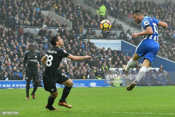 Brighton's Israeli striker Tomer Hemed heads the ball past Chelsea's Spanish defender Cesar Azpilicueta during the English Premier League football...