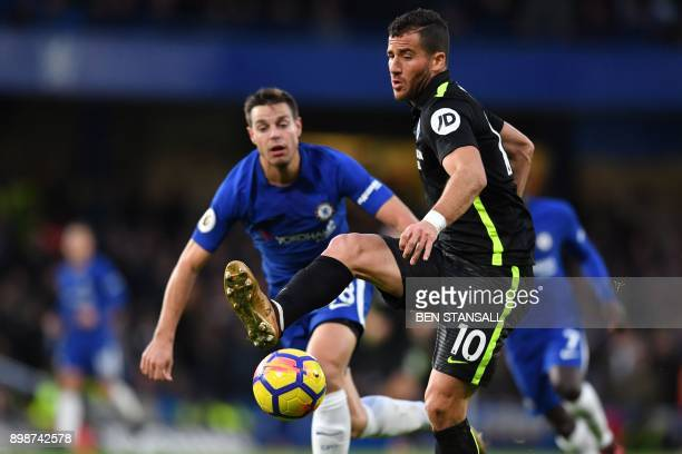 Brighton's Israeli striker Tomer Hemed passes the ball during the English Premier League football match between Chelsea and Brighton and Hove Albion...