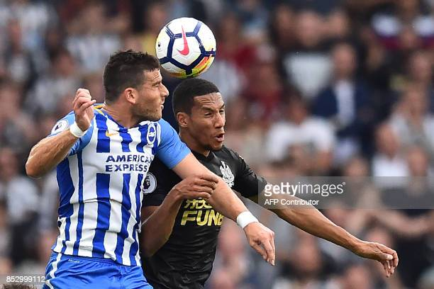 Brighton's Israeli striker Tomer Hemed vies with Newcastle United's Enlish midfielder Isaac Hayden during the English Premier League football match...
