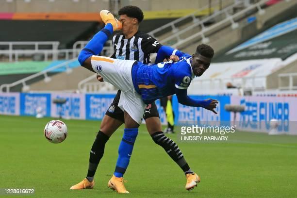 Brighton's Ivorian midfielder Yves Bissouma is sent off for this challenge on Newcastle United's English-born Northern Irish defender Jamal Lewis...