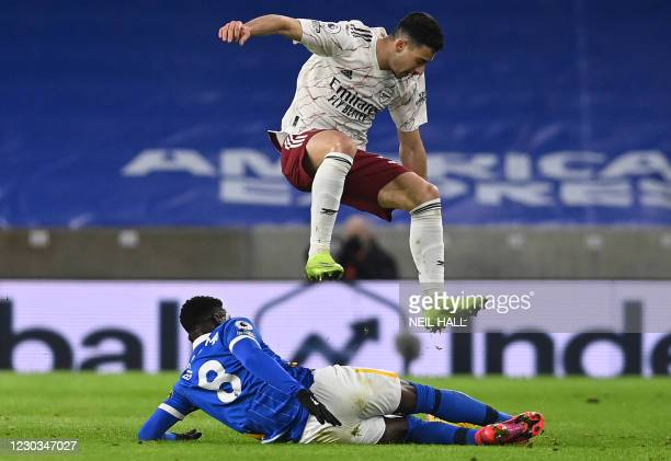 Brighton's Ivorian midfielder Yves Bissouma tackles Arsenal's Brazilian striker Gabriel Martinelli during the English Premier League football match...