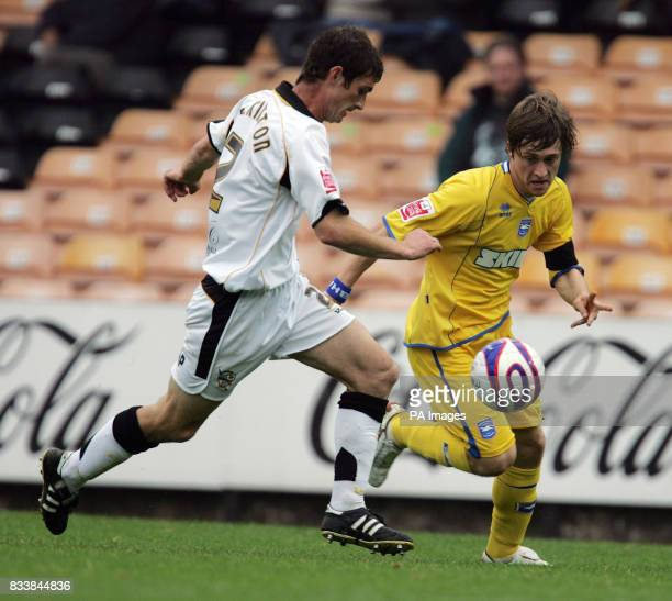 Brighton's Jake Robinson challenges Port Vale's George pilkington for the ball during the CocaCola League One match at Vale Park StokeonTrent
