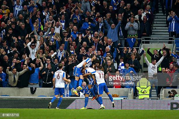 Brighton's Lewis Dunk celebrates with team mates after scoring the teams third goal during the Sky Bet Championship match between Brighton Hove...