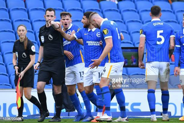 Brighton's players argue against a penalty from referee ChrisKavannagh during the English Premier League football match between Brighton and Hove...