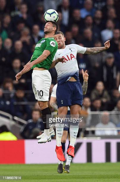 Brighton's Romanian striker Florin Andone competes with Tottenham Hotspur's Belgian defender Toby Alderweireld during the English Premier League...