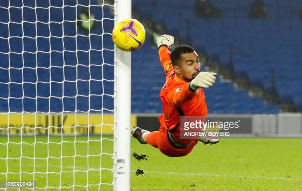 Brighton's Spanish goalkeeper Robert Sanchez saves a shot from Tottenham Hotspur's Brazilian striker Carlos Vinicius Alves Morais during the English...