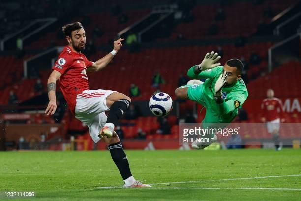 Brighton's Spanish goalkeeper Robert Sanchez saves a shot from Manchester United's Portuguese midfielder Bruno Fernandes during the English Premier...