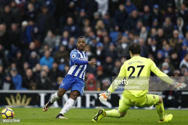 Brighton's Spanish midfielder Jose Izquierdo crosses the ball to Brighton's English striker Glenn Murray in the build up to Brighton's second goal...
