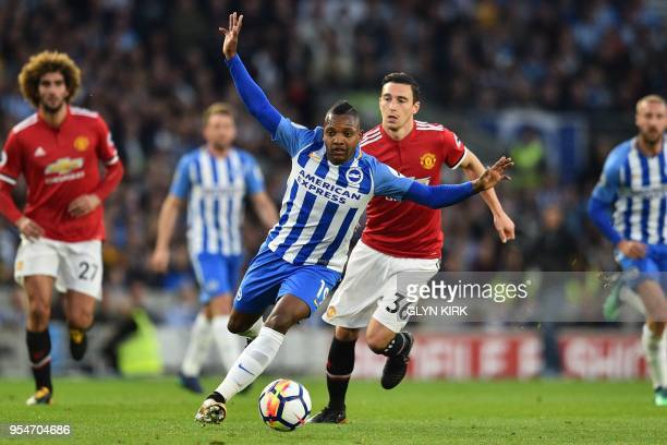 Brighton's Spanish midfielder Jose Izquierdo runs away from Manchester United's Italian defender Matteo Darmian during the English Premier League...