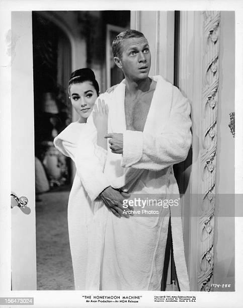 Brigid Bazlen and Steve McQueen in bathrobes in a scene from the film 'The Honeymoon Machine' 1961