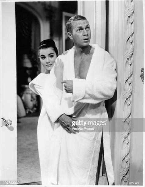 Brigid Bazlen and Steve McQueen in their bathrobes in a scene from the film 'The Honeymoon Machine' 1961