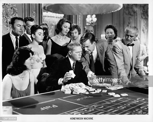Brigid Bazlen Steve McQueen Jim Hutton and Paula Prentiss playing craps in a scene from the film 'The Honeymoon Machine' 1961