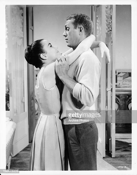 Brigid Bazlen with her arms around Steve McQueen neck in a scene from the film 'The Honeymoon Machine' 1961