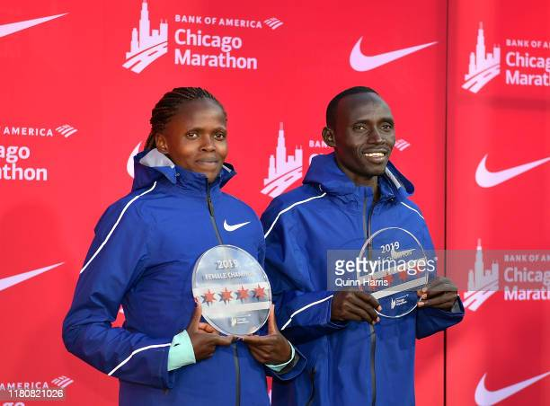 Brigid Kosgei of Kenya and Lawrence Cherono of Kenya pose for a photo after winning the 2019 Bank of America Chicago Marathon on October 13, 2019 in...