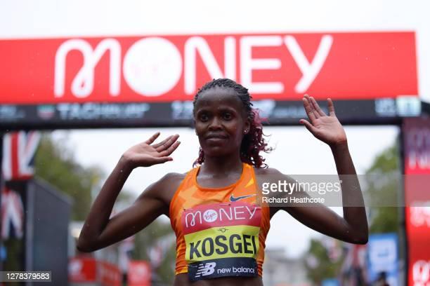 Brigid Kosgei of Kenya celebrates after winning in the Elite Women's Field during the 2020 Virgin Money London Marathon around St. James's Park on...