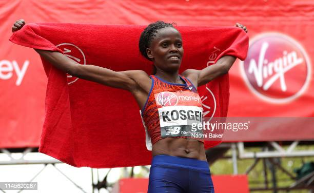Brigid Kosgei of Kenya celebrates winning the Women's Elite race during the 2019 Virgin Money London Marathon in the United Kingdom on April 28 2019...
