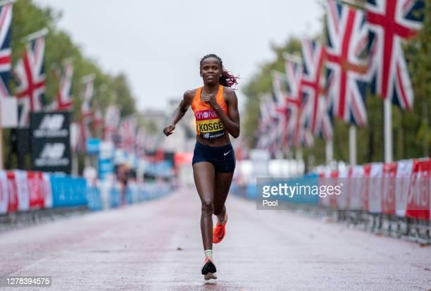 Brigid Kosgei of Kenya competes in the Elite Women's Field during the 2020 Virgin Money London Marathon around St James on October 04, 2020 in...
