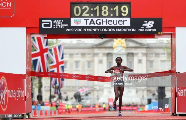 Brigid Kosgei of Kenya crosses the line to win the Women's Elite race during the 2019 Virgin Money London Marathon in the United Kingdom on April 28...