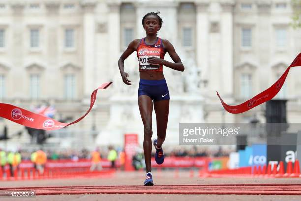 Brigid Kosgei of Kenya crosses the line to win the Women's Elite race during the Virgin Money London Marathon at United Kingdom on April 28 2019 in...