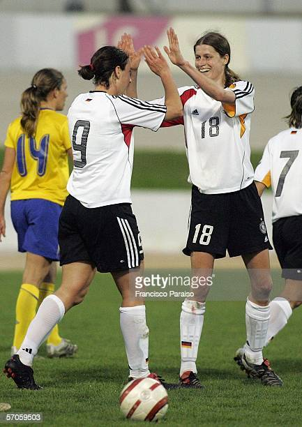 Brigit Prinz and Kerstin Garefrekes of Germany celebrate after Birgit Prinz shoots the third goal during the Womens Algarve Cup match between Germany...