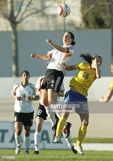 Brigit Prinz of Germany and Theresa Sjogran of Sweden jump for the ball during the Womens Algarve Cup match between Germany and Sweden on March 11,...