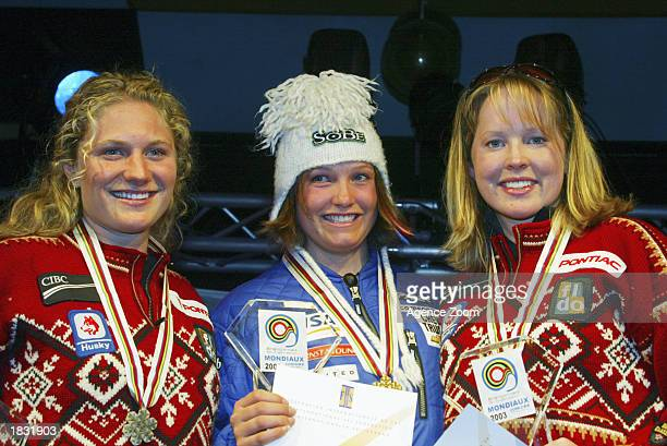 Brigitte Acton of Canada 2nd place Julia Mancuso of USA 1st place and Kelly Vanderbeek of Canada 3rd place celebrate with their medals after the...