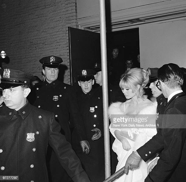 Brigitte Bardot and her boyfriend Bob Zaguri leave the Astor under heavy police escort Her white coat became sullied while exiting through kitchen to...