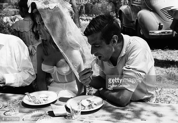 Brigitte Bardot and her husband Roger Vadim enjoying a meal during the Cannes Film Festival in 1956