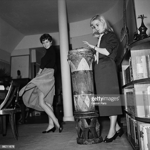 Brigitte Bardot and Isabelle Pia at Marc Allegret at the time of the shooting of film 'Futures vedettes' France 1955