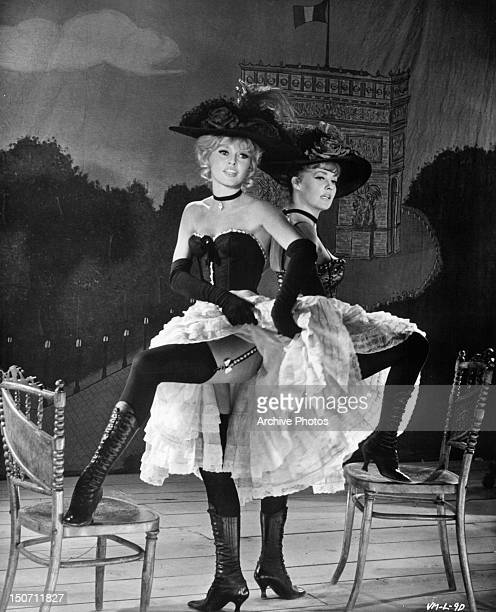 Brigitte Bardot and Jeanne Moreau performing on stage together in a scene from the film 'Viva Maria' 1965