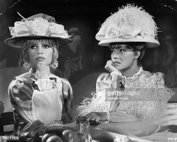 Brigitte Bardot and Jeanne Moreau with concerned looks in a scene from the film 'Viva Maria' 1965