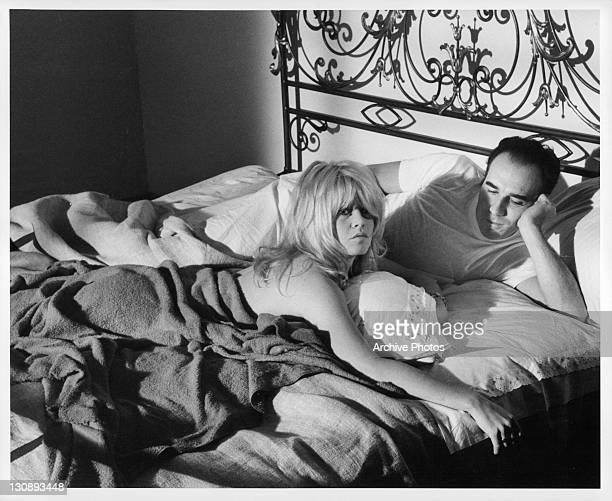 Brigitte Bardot and Michel Piccoli in bed in a scene from the film 'Contempt', 1963.