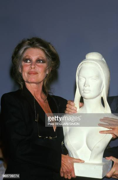 Brigitte Bardot Holding the Bust Of Marianne She Posed For At Auction June 17 1987