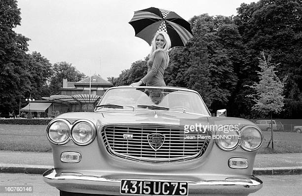 Brigitte Bardot in a Lancia convertible in May 1967 in France