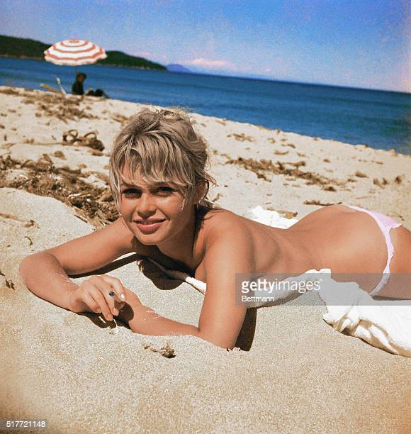 Brigitte Bardot, originally Camille Javal, actress, pictured here on a towel, sunning on the beach.