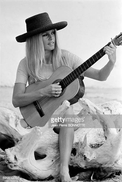 Brigitte Bardot Playing Guitar on A Beach in France on September 9 1967