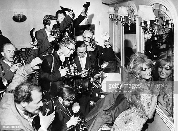 Brigitte BARDOT posing front of a mirror at the Mount Royal Hotel for the benefit of photographers She was in England to make a film for Columbia...